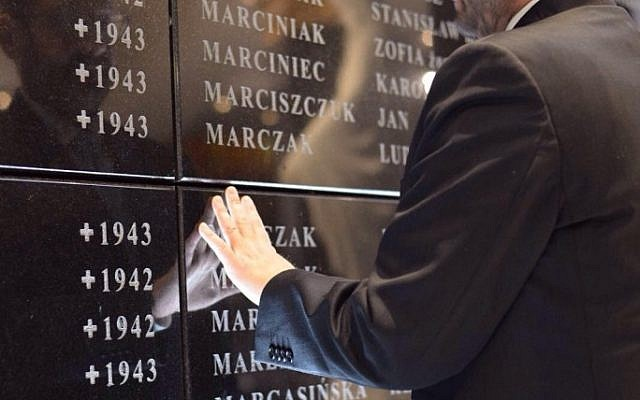 Reading names engraved in the memorial wall (credit: Laura Ben David)