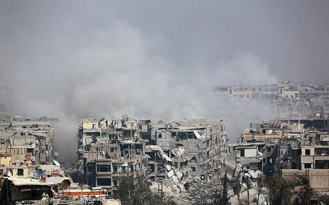 Smoke billows following Syrian government bombardment on the rebel-held besieged town of Harasta, in the Eastern Ghouta region on the outskirts of Damascus on March 12, 2018. (AFP PHOTO)