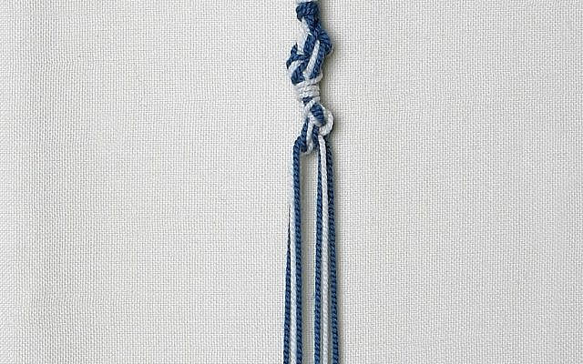 Illustrative: Tzitzit tassels with threads dyed in tekhelet blue produced from Murex trunculus snails (courtesy of Ptil Tekhelet/Eugene Weisberg)