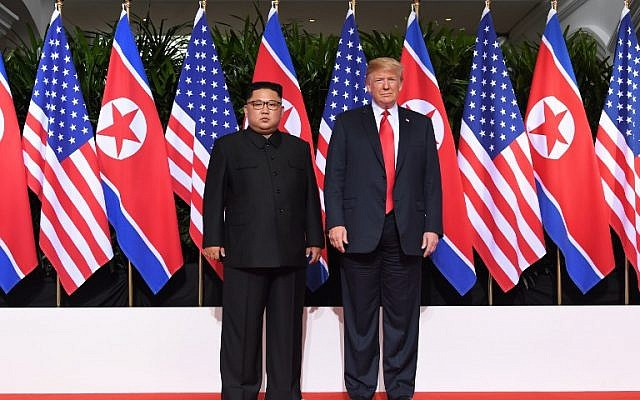 US President Donald Trump (R) poses with North Korea's leader Kim Jong Un (L) at the start of their historic US-North Korea summit, at the Capella Hotel on Sentosa island in Singapore on June 12, 2018. (AFP PHOTO / SAUL LOEB)