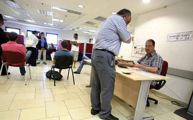 A client seeks work at an unemployment office in Jerusalem (Photo by Yossi Zamir/Flash90)