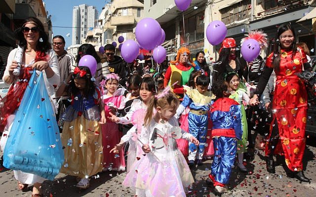 Children of migrant workers wear costumes as they celebrate Purim in south Tel Aviv in 2012 (photo credit: Roni Schutzer/Flash90)