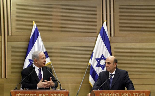 Prime minister Benjamin Netanyahu and  Kadima chairman Shaul Mofaz, hold a joint press conference announcing a unity government, on Tuesday (photo credit: Miriam Alster/Flash90)