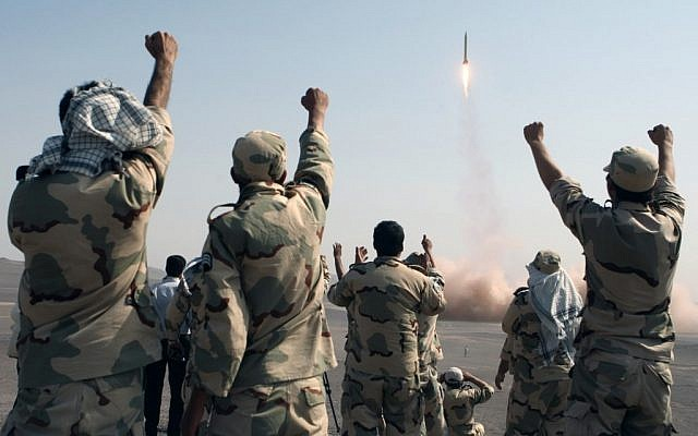 Members of the Iranian Revolutionary Guards Corp celebrate after a missile launch in July 2012 (AP/IRNA, Mostafa Qotbi)