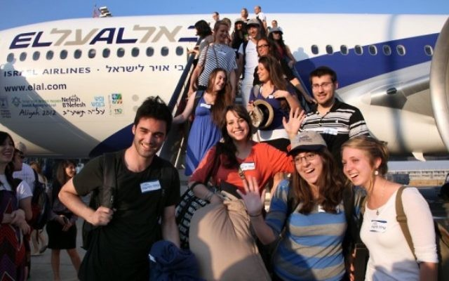 A group of 229 new Olim arrived in Israel through Nefesh B'Nefesh on the summer's first chartered aliya flight. (photo credit: Sason Tiram)