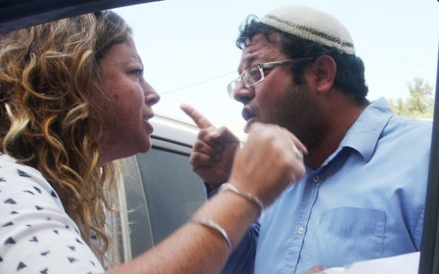 Right-wing activist Itamar Ben Gvir argues with Noa Rothman, Yitzhak Rabin's granddaughter, August 14, 2012 (photo credit: Roni Schutzer/Flash90)