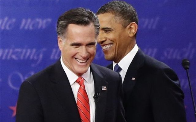 President Barack Obama and Republican presidential candidate and former Massachusetts Gov. Mitt Romney talk at the end of the first presidential debate in Denver, October 3, 2012. (AP Photo/Charles Dharapak)