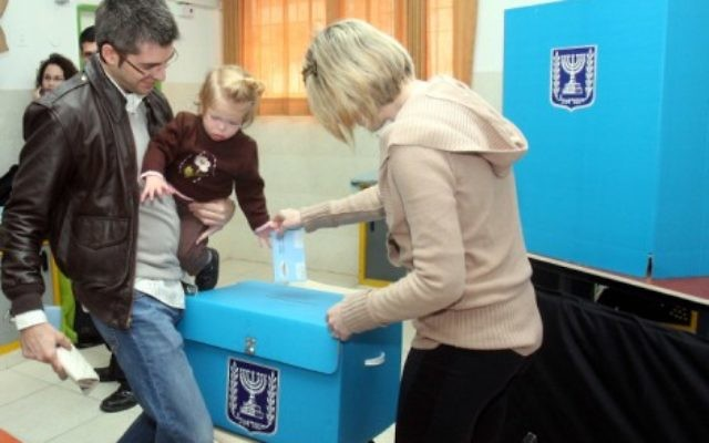 These elections are, in fact, all about linkages. An Israeli family cast their ballots at a polling station in 2009 (photo credit: Flash90)