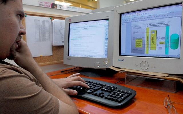 Illustrative photo of a software developer at an Israeli start-up working on a project. (Gili Yaari/Flash90)
