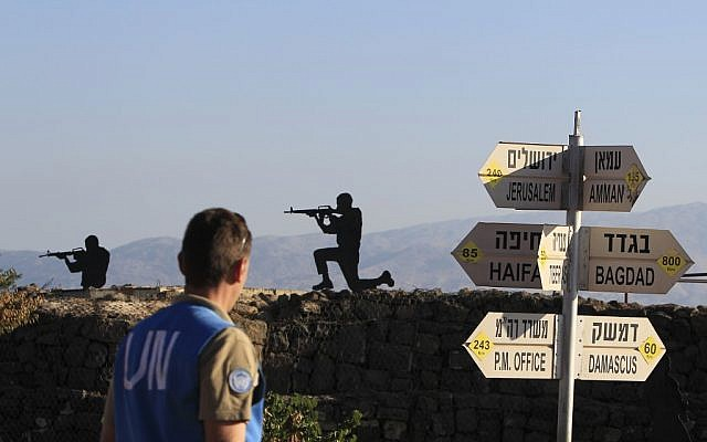 A UN peacekeeper near the Israel-Syria border (photo credit: Tsafrir Abayov/Flash90)