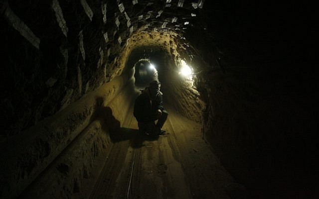 A Palestinian worker inside a smuggling tunnel, beneath the Egyptian-Gaza border in the southern Gaza Strip, in February 2013 (photo credit: Abed Rahim Khatib/Flash90)