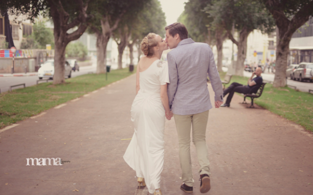 Newlyweds stroll down Tel Aviv's Rothschild Boulevard (photo credit: Mama Photography)