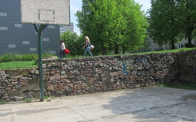 Jewish gravestone were used to build this school basketball court in Vilna, Lithuania. Now the evidence has been removed. (photo: DefendingHistory.com)