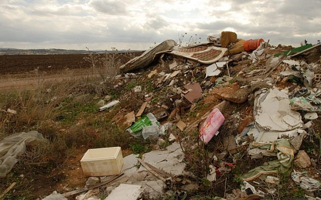 Illegal waste dumping site in a field in Israel, Nov 21, 2008. (photo credit: Gili Yaari/Flash 90)