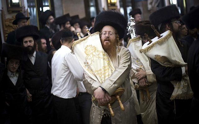 'Let's not lose sight of the true values that Haredim bring to the table: true belief in the Torah as the central force upholding the Jewish people' (illustrative image: dancing in Simhat Torah celebrations in Jerusalem's Mea Shearim neighborhood October, 2012  via Shutterstock)