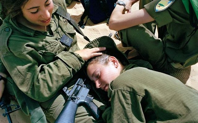 IDF Women Soldiers Being Nice, Photo Too Boring to be News (Photo: CC-BY-SA Artur Andrychowski, Google Images)