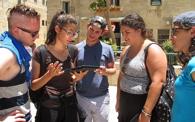Onward Israel participants with iPads in hand take an interactive 'Jew Quest' through Jerusalem's Old City. (photo credit: Leeor Bronis/Times of Israel)