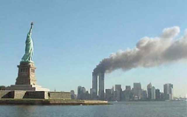 The Twin Towers burning on a beautiful September day in New York City Photo Credit: By National Park Service (http://www.nps.gov/remembrance/statue/index.html) [Public domain], via Wikimedia Commons