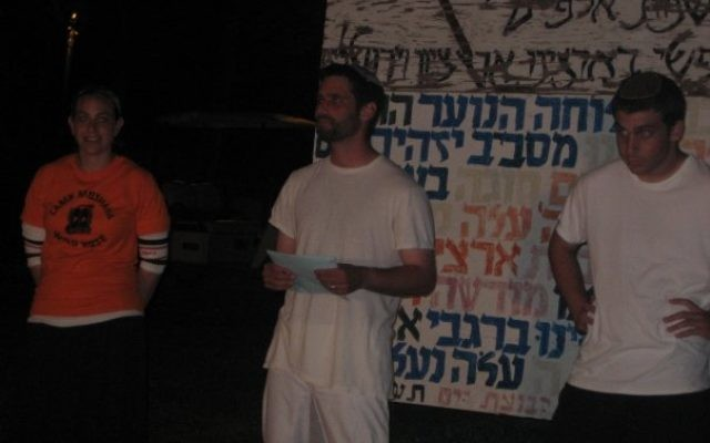 The author (right) running a Zionist night-activity in Camp Moshava, Wild Rose in July of 2008. (Doni Kandel)