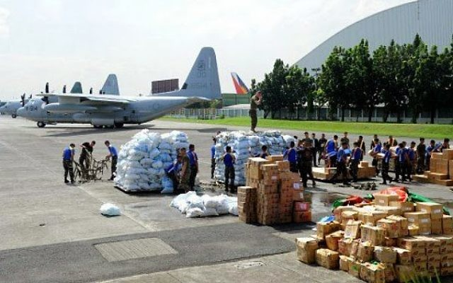"""Donated goods awaiting to be loaded to go to """"survivors"""" on surrounding  islands"""