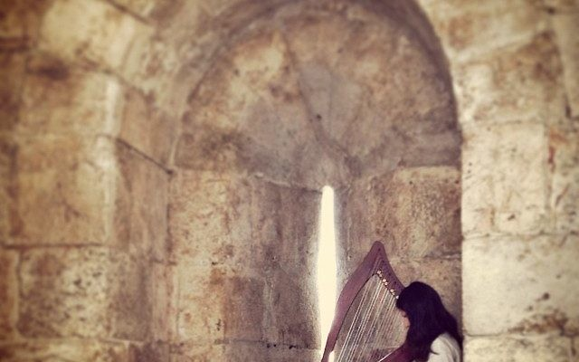 An angel plays the harp at Jaffa Gate. Photo by Sarah Tuttle-Singer