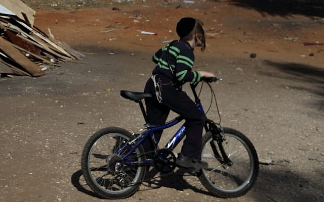 Bnai Brak youth riding a bike (Photo cedit:  Photo by Yaakov Naumi/Flash90)