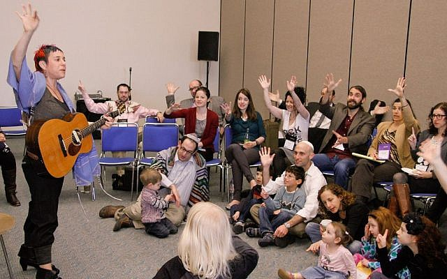 Illustrative: A group meeting for a 'P'sukei D'zimra' morning service before the main Shabbat worship service at the Reform biennial in San Diego, December 14, 2013. (URJ via JTA/File)