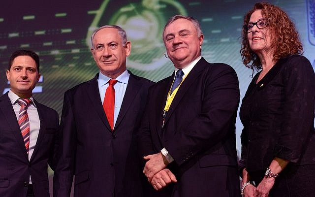Prime Minister Benjamin Netanyahu with President of Ben Gurion University Prof. Rivka Karmi (R), Vice President of IBM, Steve Mills (2-R), and Mayor of Beersheva, Rubik Danilovich (L), at Cybertech 2014. (Photo credit: Kobi Gideon/GPO/Flash 90)