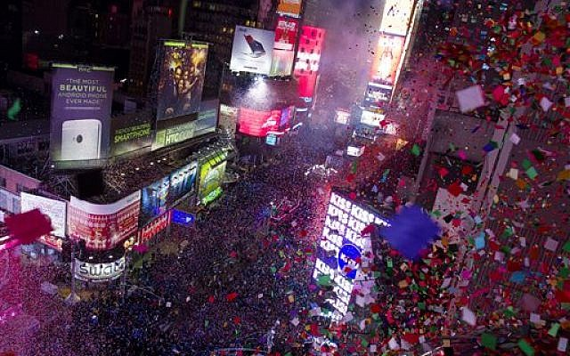 Confetti flies over Times Square in New York  as the new year is celebrated, Wednesday, Jan. 1, 2014. (photo credit: AP/Craig Ruttle)
