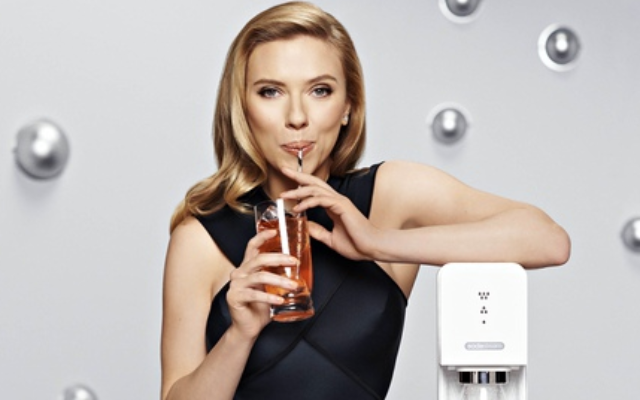 if you tell me Scarlett Johansson is not perceived by every American as a white women, I don't know what to tell you. (Photo: SodaStream)