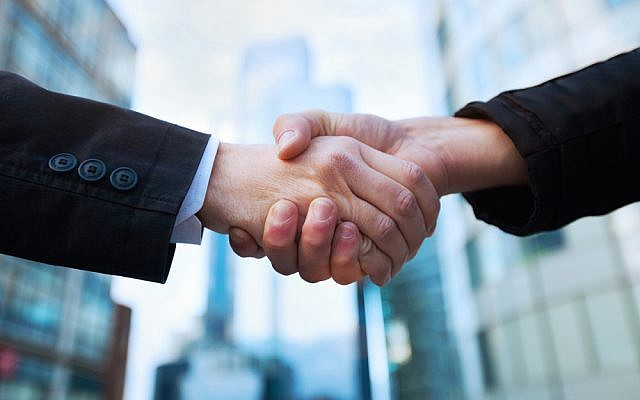 handshake (handshake image via Shutterstock)