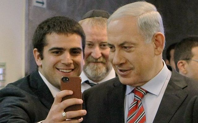 A student takes a 'selfie' with Prime Minister, Benjamin Netanyahu, March 30, 2014 (photo credit: Danny Meron/POOL/Flash90)