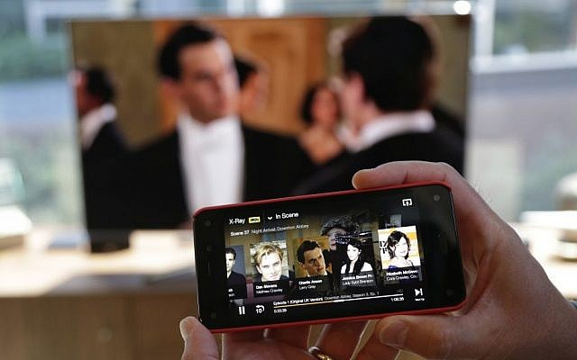TV by phone (AP Photo/Ted S. Warren)
