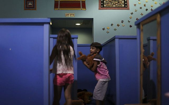 Kids playing in a specially designed, 21,000-square-foot indoor play space in Sderot, featuring five bomb shelters. (illustrative photo credit: Hadas Parush)