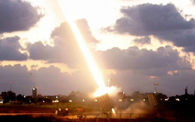 An Iron Dome missile defense battery set up near the southern Israeli town of Ashdod fires an intercepting missile on July 16, 2014 (photo credit: Miriam Alster/Flash90)
