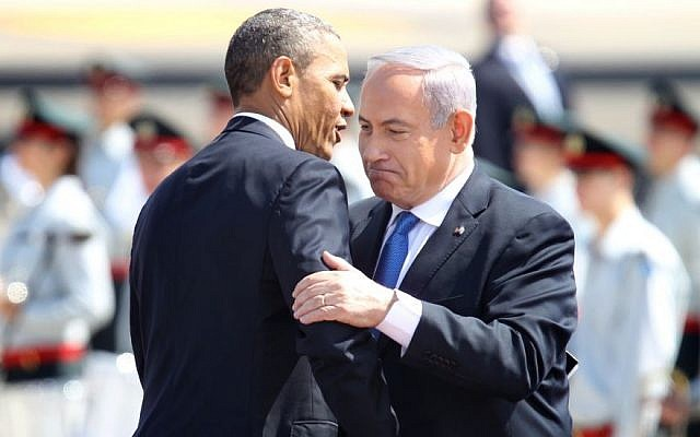 Prime Minister Benjamin Netanyahu, right, and President Barack Obama embrace at a ceremony welcoming the US leader at Ben Gurion Airport near Tel Aviv, on March 20, 2013 (Miriam Alster/Flash90)