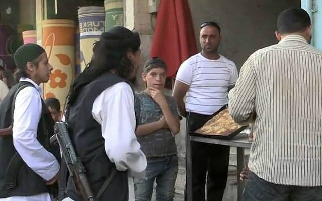 Islamic State authorities enforcing Sharia law with local shopkeepers in Raqqa, Syria. (photo credit: YouTube screen capture/Vice News)