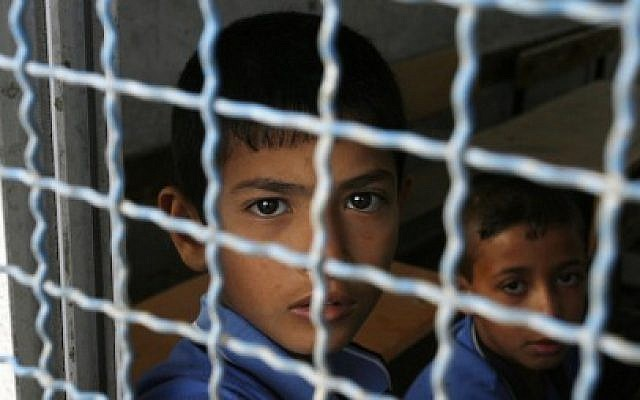 Illustrative photo: Palestinian students sit inside UN-run school in Rafah refugee camp in the southern Gaza Strip September 14, 2014. (Abed Rahim Khatib/Flash90)