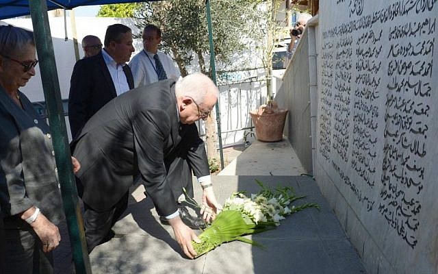 President Reuven Rivlin laying a wreath at Kafr Kassem Sunday, October 26 (photo credit: Courtesy/ President's spokesman)
