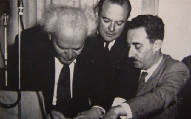 Ben-Gurion (left) signing Israel's Declaration of Independence held by Moshe Sharet at the Tel Aviv Museum on May 14, 1948.