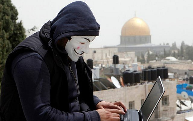 A Palestinian hacker on the backdrop of the Dome of the Rock on April 8, 2013 (photo credit: Sliman Khader/ Flash 90)