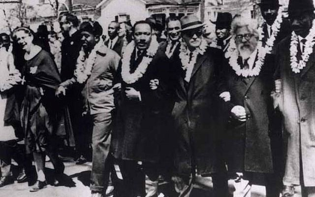 Rabbi Abraham Joshua Heschel (second from right), marches at Selma with Rev. Martin Luther King, Jr., Ralph Bunche, Rep. John Lewis, Rev. Fred Shuttlesworth and Rev. C.T. Vivian. (Courtesy of Susannah Heschel)