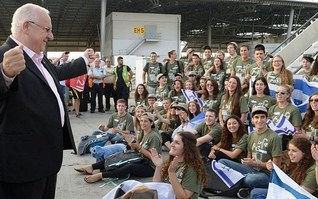 Illustrative photo: President Reuven Rivlin welcomes new immigrants from the US and Canada at Ben Gurion Airport, August 12, 2014. The arrivals, on a Nefesh B'Nefesh 'Soldiers Flight', were set to join the Israel Defense Forces. (Photo credit: Mark Neyman/GPO/ FLASH90)