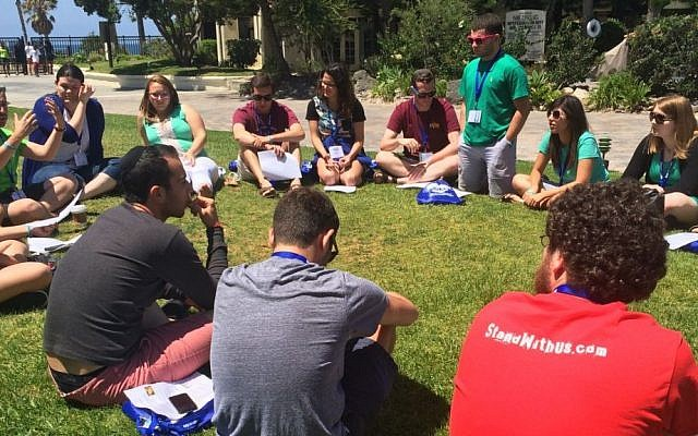 At a StandWithUs Emerson Fellowship training in Los Angeles in late August, students discuss the Iran deal and how to bring it to campus. (courtesy)