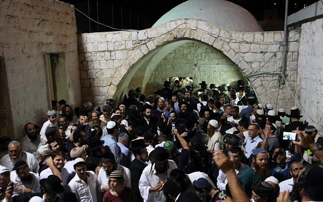 Illustrative: Hundreds of ultra Orthodox Jewish men pray near the compound of Joseph's Tomb in the West Bank city of Nablus early on June 10, 2013. (Yaakov Naumi/Flash90/File)