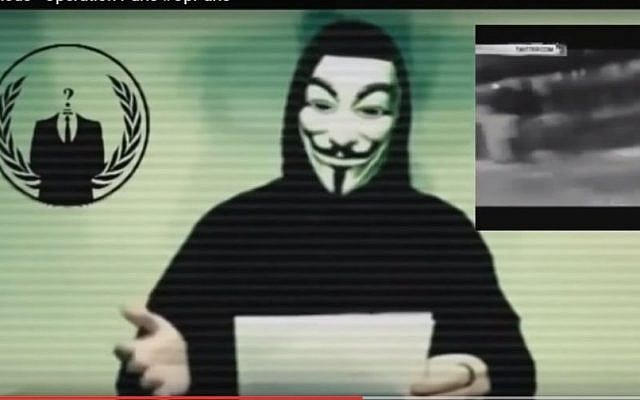 A capture from a video posted by the Anonymous hacker group on YouTube on Monday, November 16 2015 in which the group vows to fight Islamic State in revenge for its attacks on Paris. (Screen Capture YouTube)