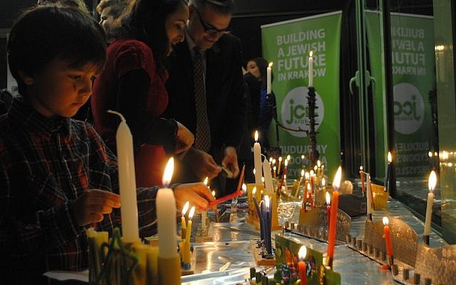 Lighting menorahs earlier this week in Krakow, Poland. (Shavei Israel)