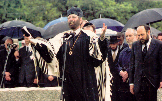 During a 2001 memorial service in the Polish town Jedwabne, Jews commemorate the WWII murder of its Jewish community by Polish neighbors. (Wikimedia Commons)