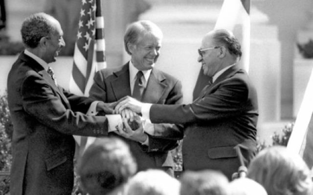 Egypt's president Anwar Sadat, US preseident Jimmy Carter, and Israeli prime minister Menachem Begin, signing the Camp David Accords (1979). (Government Press Office)