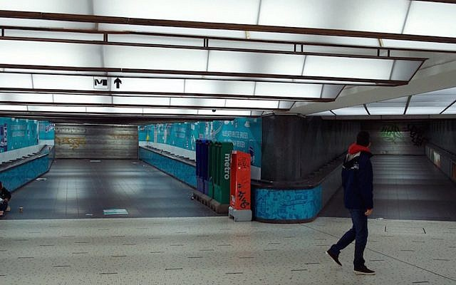 A man walking in an empty tunnel of the closed subway central station in Brussels, Belgium, Nov. 21, 2015. (Nicolas Maeterlinck/AFP/Getty Images)
